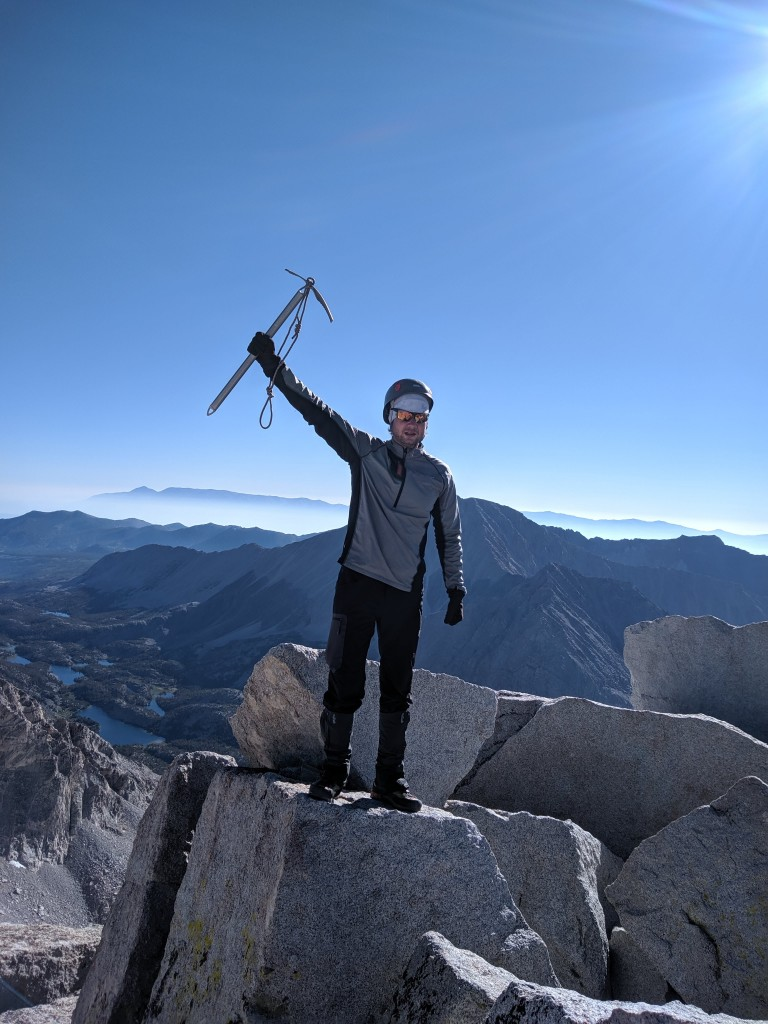 Pasha Gilchuk on the summit of Mt. Dade. Photo credit Andrew Kiselev.