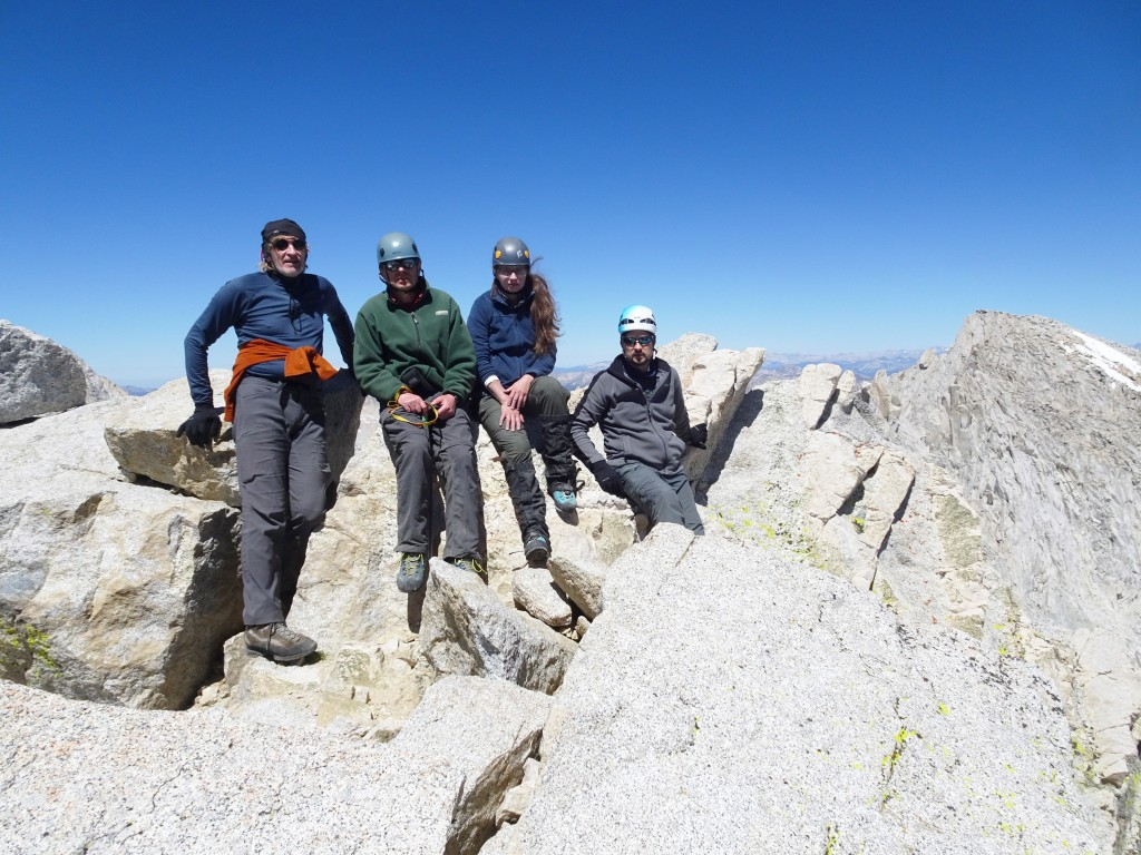 The summit of mt. Dade, 13,600 ft. Sergey Los, Alexander Bukreyev, Nadiya Teplyuk, Rodion Turuikhan (left to right). Photo credit Oleg Shakhtmeyster.
